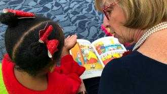 Dewine reading to child